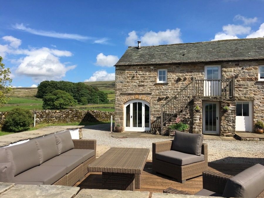 Angel Barn has a super decked area with all weather sofas and amazing views!