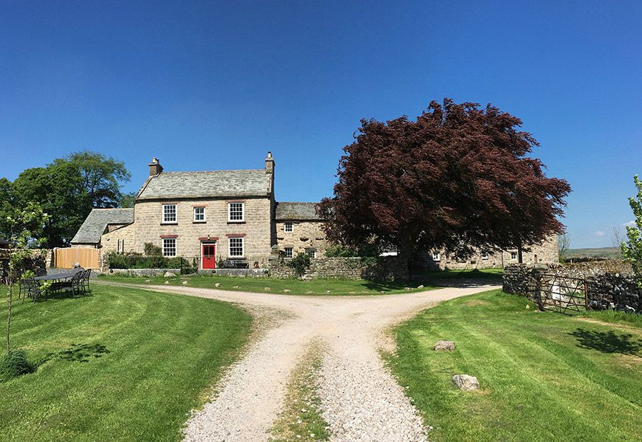 The Farmhouse on the left, the Shepherd's Cottage in the middle & Angel Barn is hiding behind the huge copper beech tree on the right