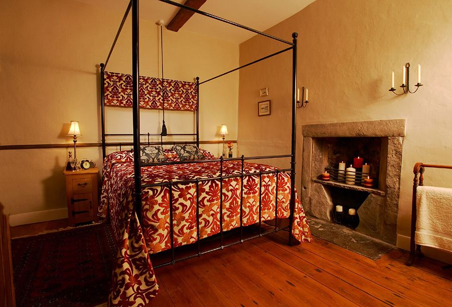 Bedroom 4 has a double four poster bed