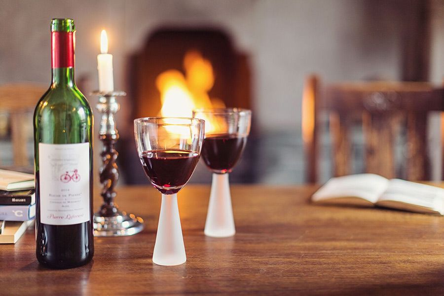 Take time to enjoy your favourite glass of red in front of the fire