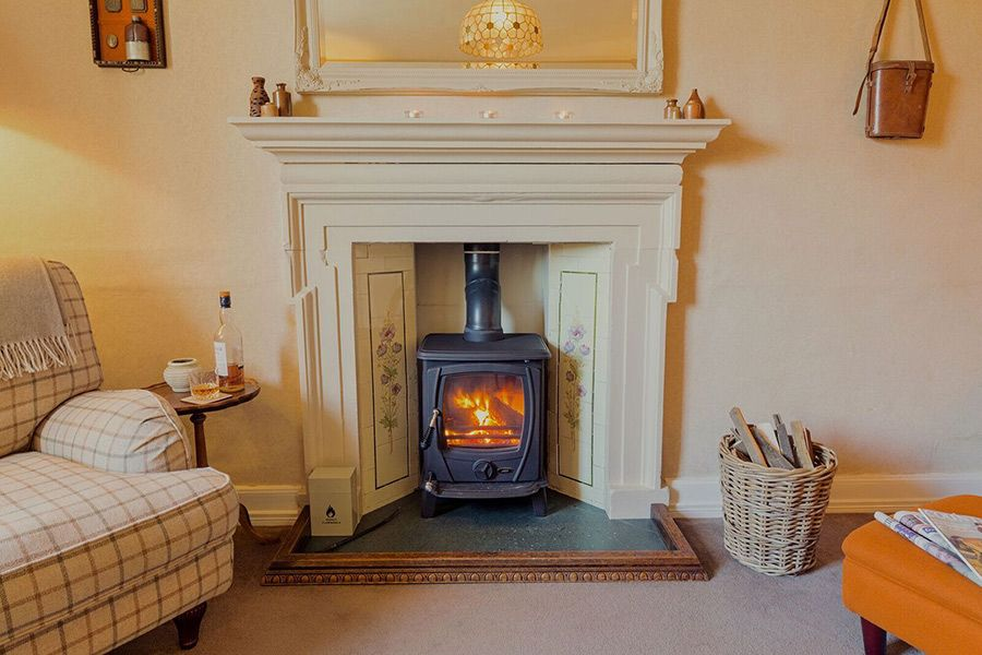 Get toasty in front of the Aga wood burning stove