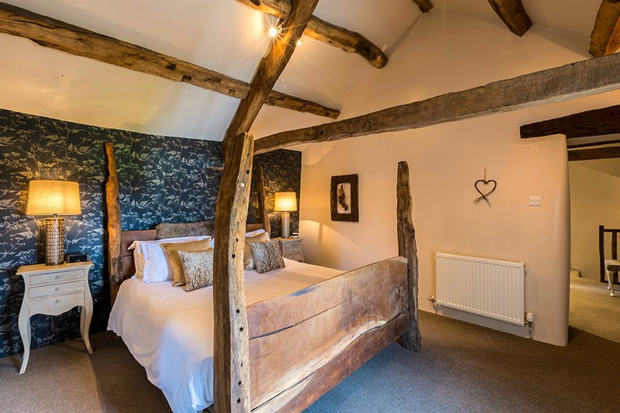 Gaze up at the 400 year old beams from the Kingsize four poster bed