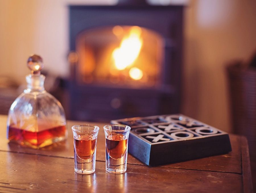 Try some of our homemade gin in front of the fire