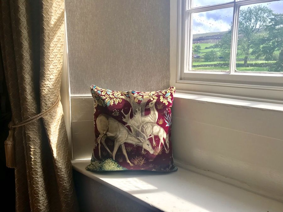 Lovely window seat with velvet cushions