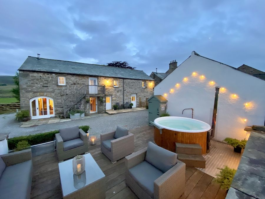 Angel Barn and outdoor lounge with wood fired hot tub