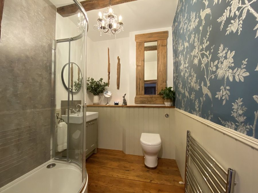 The spacious shower room is located next to the Bedrooms